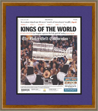 "Newspaper Frame. LA Kings Win 2012 Stanley Cup. Frame #801 Walnut Finish 1 1/8"". Outer Mat Dark Purple, Inner Mat Black Belt. Price $98.95 as configured"