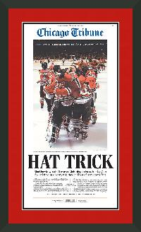 "Newspaper Display Frame. Chicago Blackhawks Win 2015 Stanley Cup. Frame #203 Matte Black 1 3/16"". Outer Mat All American Red, Inner Mat Black Belt. Price $113.95 as configured"
