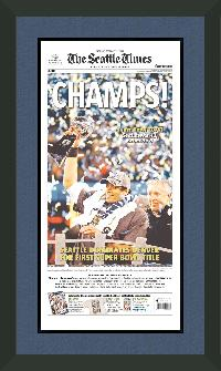 "Newspaper Frame. Seattle Wins 2014 Super Bowl. Frame #207 Matte Black 1 1/2"". Outer Mat Jeans, Inner Mat Black-n-Blue.  Price $131.95 as configured"