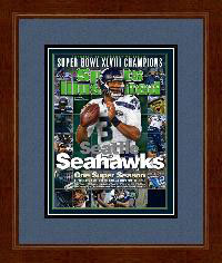 "Magazine Frame. Seattle Wins 2014 Super Bowl. Frame #693 Mahogany 1 3/8"". Outer Mat Jeans, Inner Mat Black-n-Blue. Price $81.95 as configured"